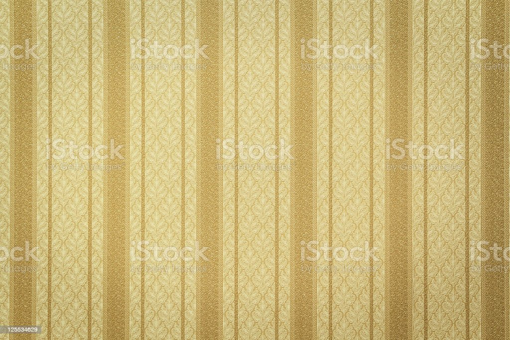 Gold striped wallpaper with floral pattern stock photo
