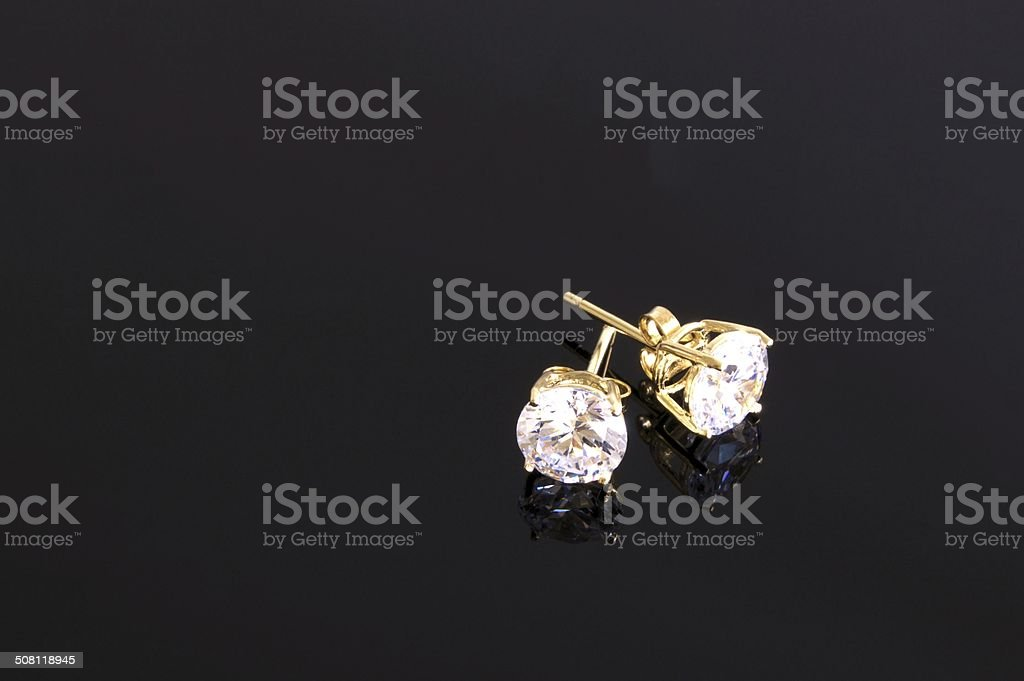 Gold stud diamond earrings stock photo