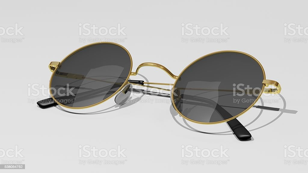 Gold sunglasses with red lenses isolated on a white background stock photo