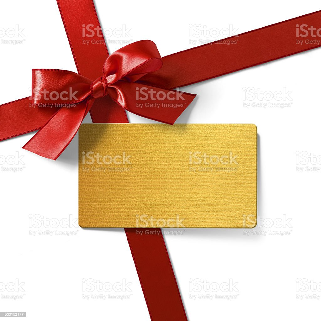 Gold tag with red satin ribbon royalty-free stock photo