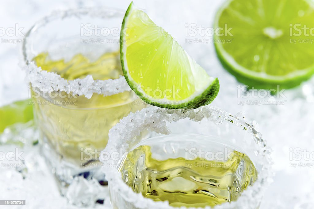 gold tequila with salt and lime royalty-free stock photo