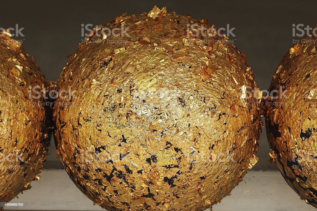 gold texture of buddhism Round stones stock photo