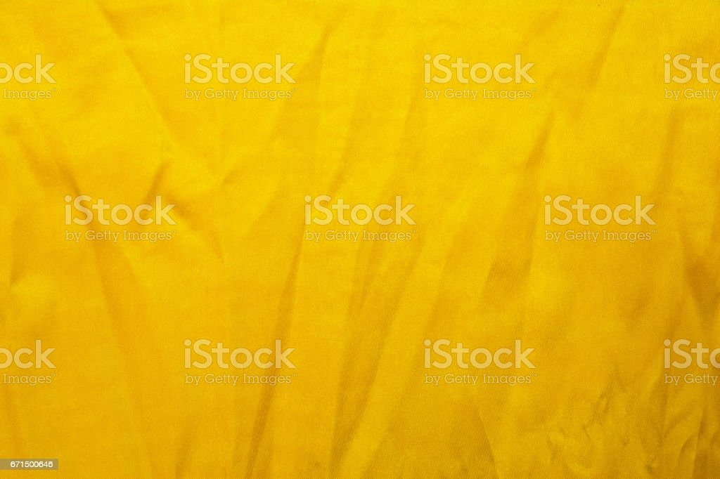 Gold thread fabric.Gold fabric.Yellow gold fabric.Gold fabric texture stock photo