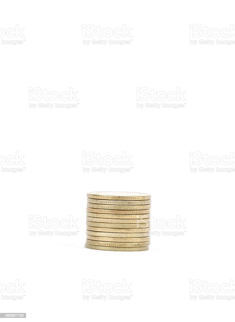 Gold towers made out of coins stock photo
