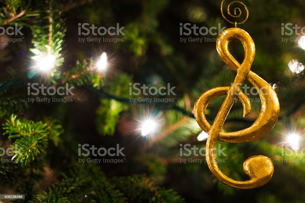 Gold Treble Clef Ornament with Christmas Tree stock photo