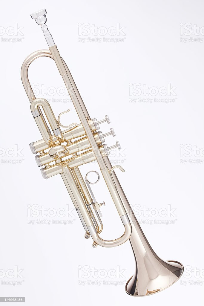 Gold Trumpet Isolated Against White stock photo