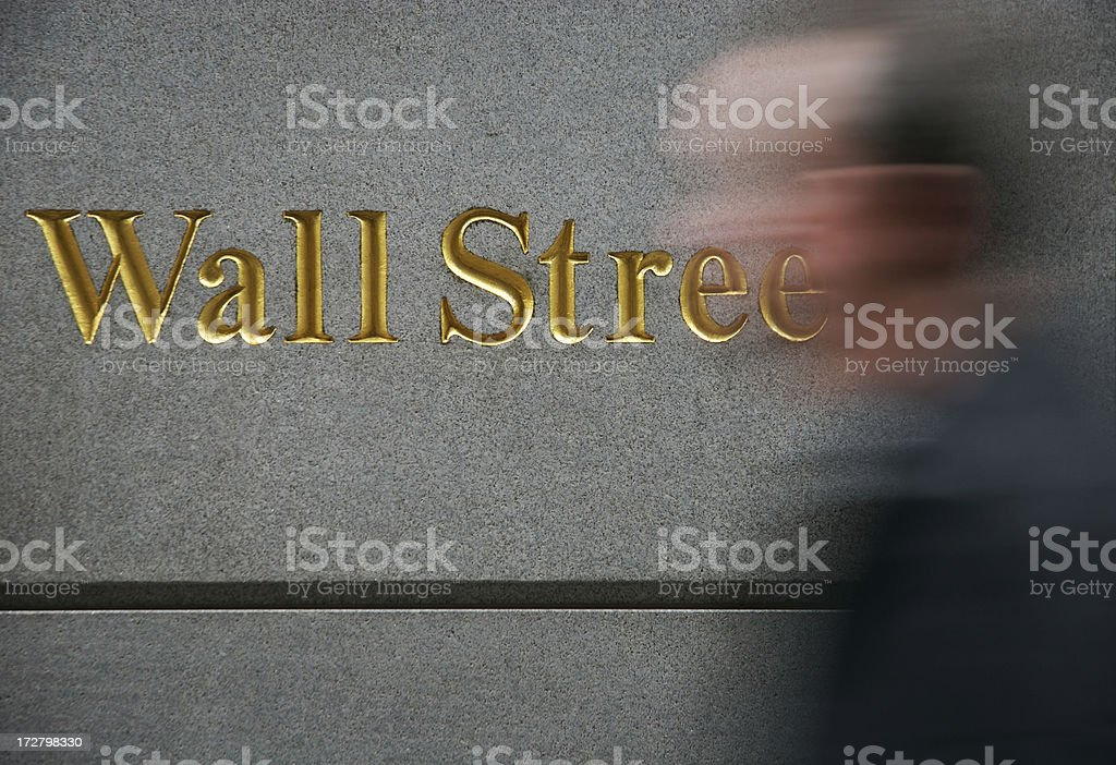 Gold Wall Street Sign Motion Blur Man royalty-free stock photo