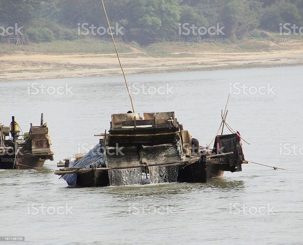 Gold washing mashine on the Irrawaddi royalty-free stock photo