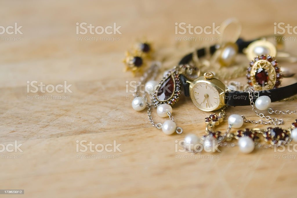 Gold watch and jewelry stock photo