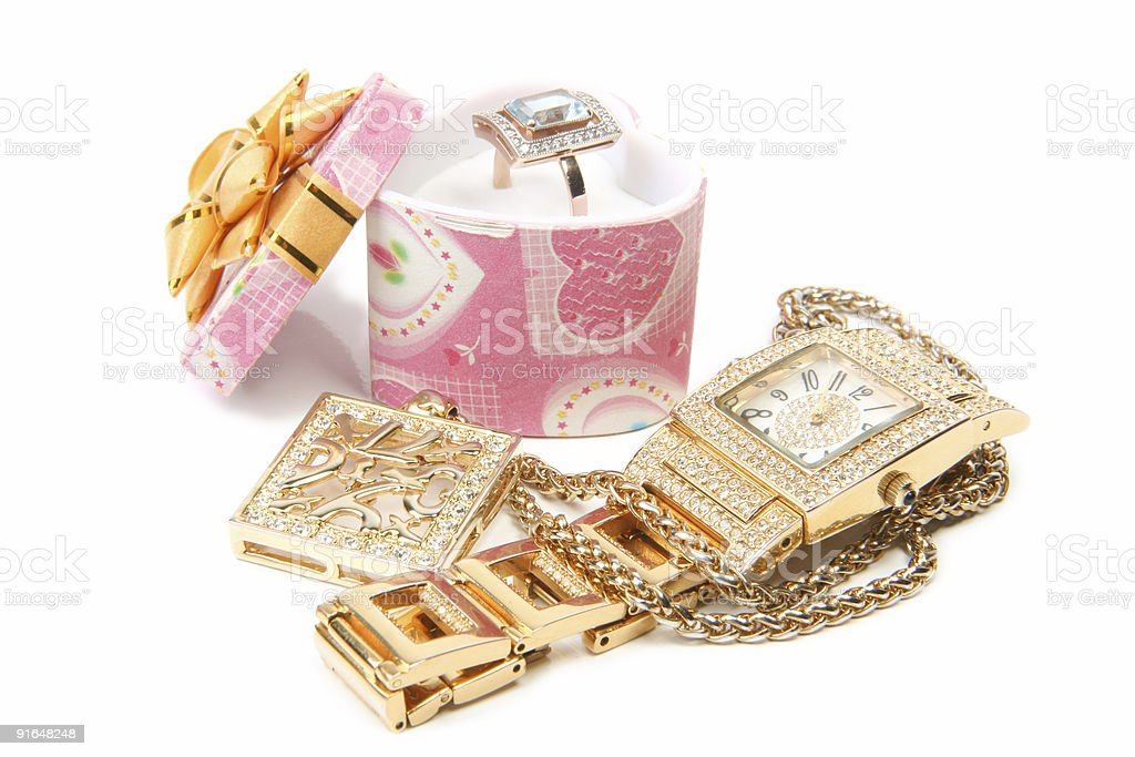 Gold watch, ring and necklace royalty-free stock photo