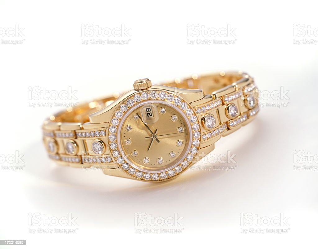 A gold watch with embedded diamonds stock photo