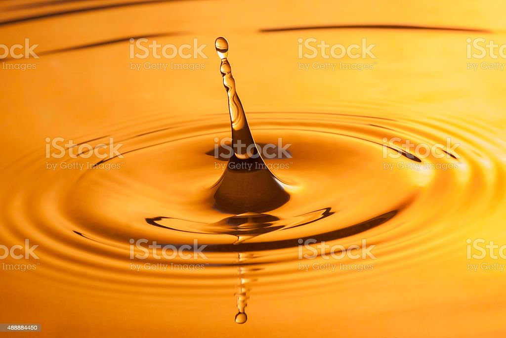 Gold water drop stock photo