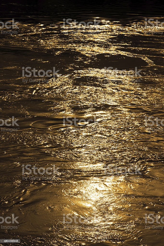 Gold water in motion stock photo