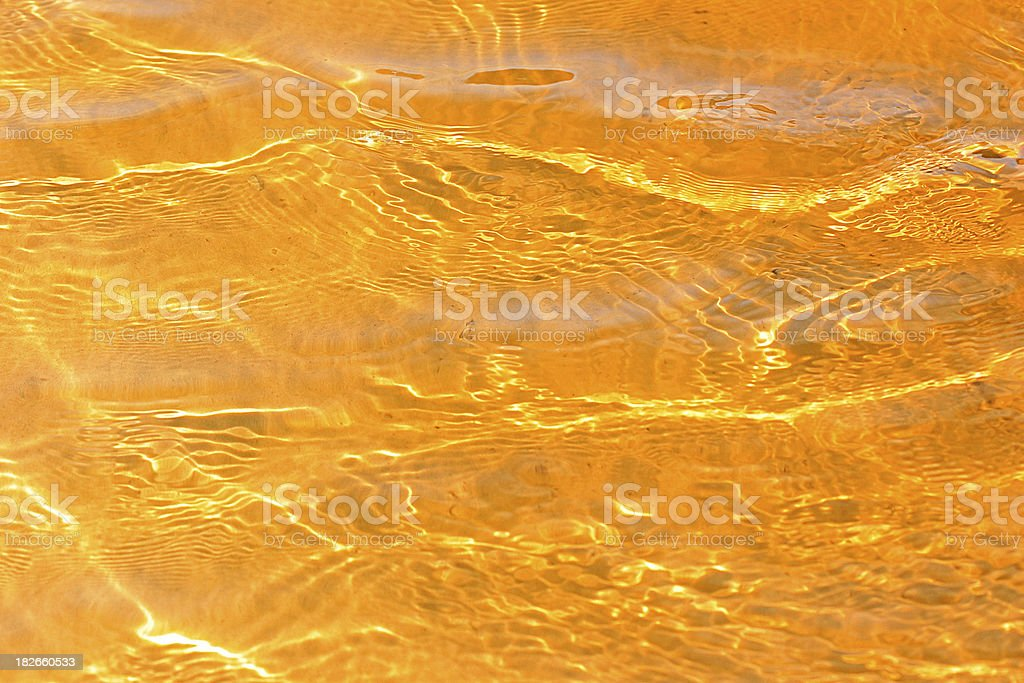 Gold water stock photo