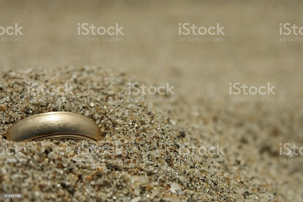 Gold Wedding Ring Lost in the Sand stock photo
