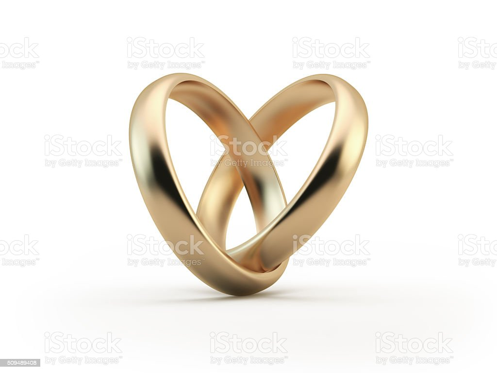 Gold Wedding Rings Forming A Heart Shape stock photo