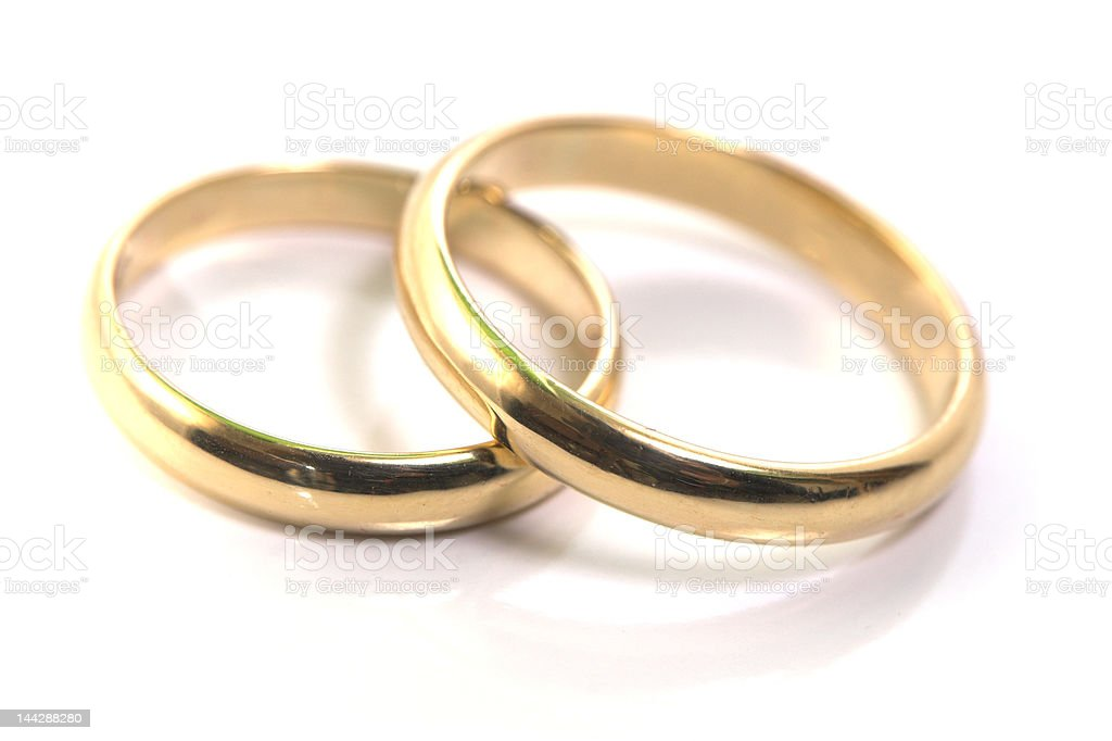 Gold wedding rings isolated on white royalty-free stock photo