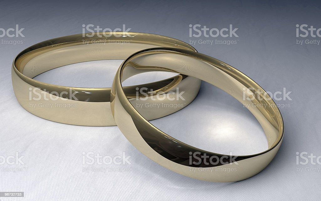 Gold Wedding Rings on White Cloth stock photo