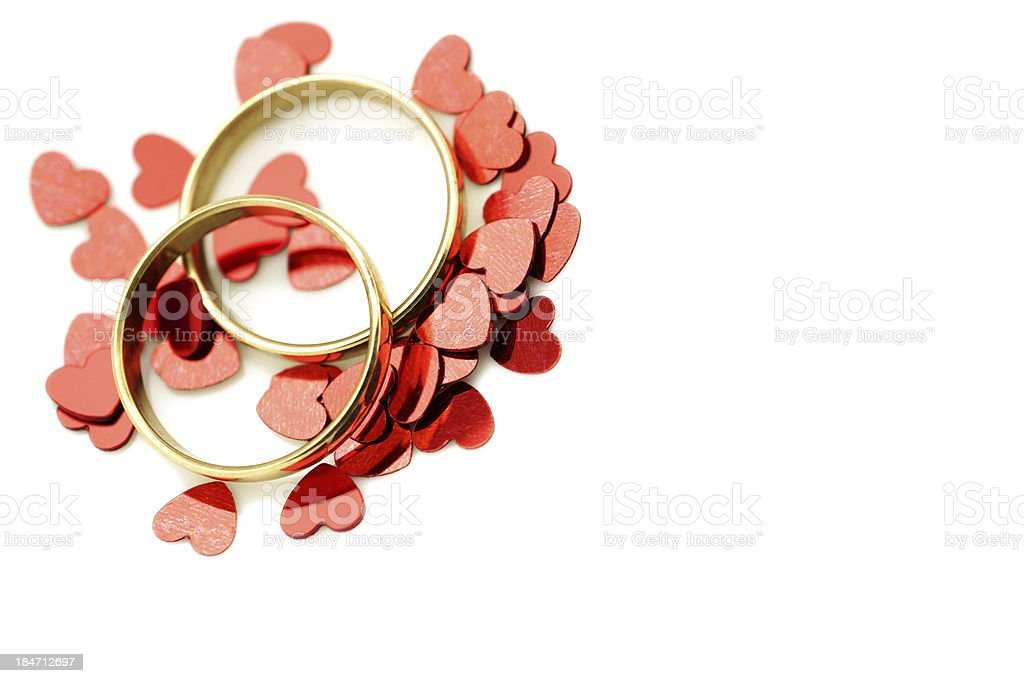 Gold wedding rings with hearts stock photo