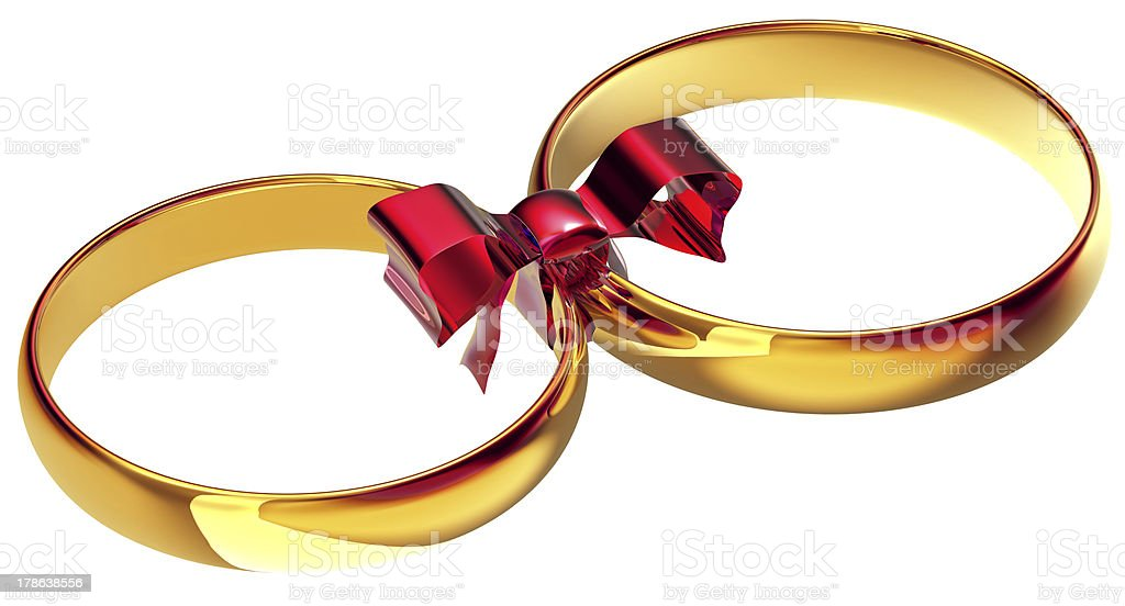 Gold wedding rings with the silk bow stock photo