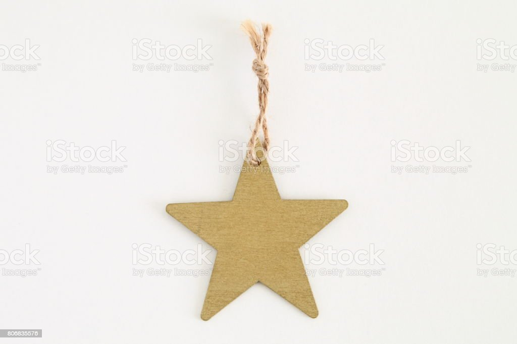 Gold wooden star shaped tag with rope isolated on white stock photo