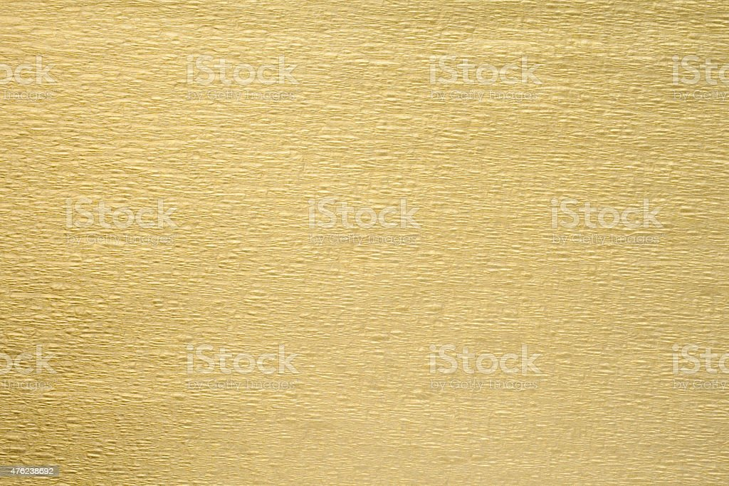 Gold wrinkle paper texture background stock photo