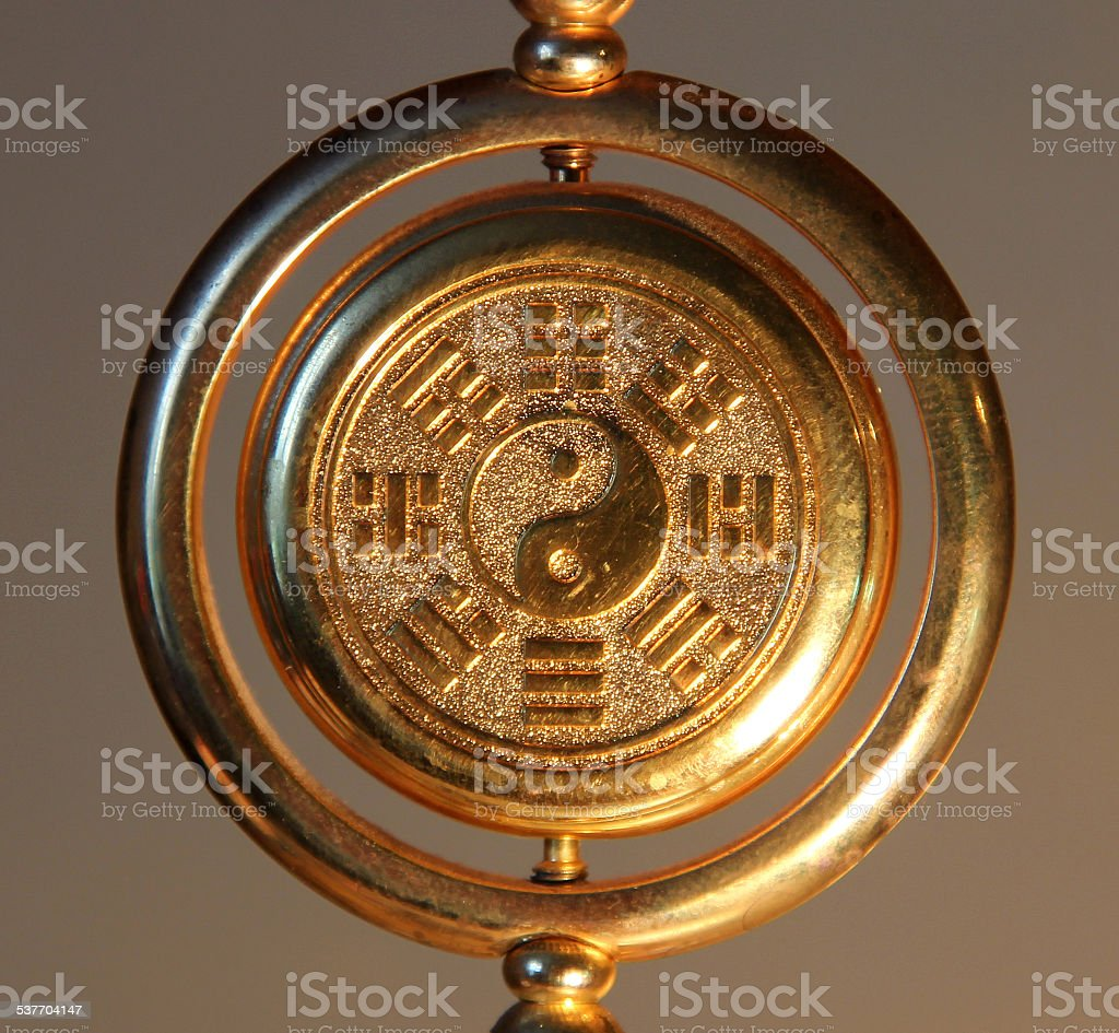 gold yin yang sign surrounded by Trigrams stock photo