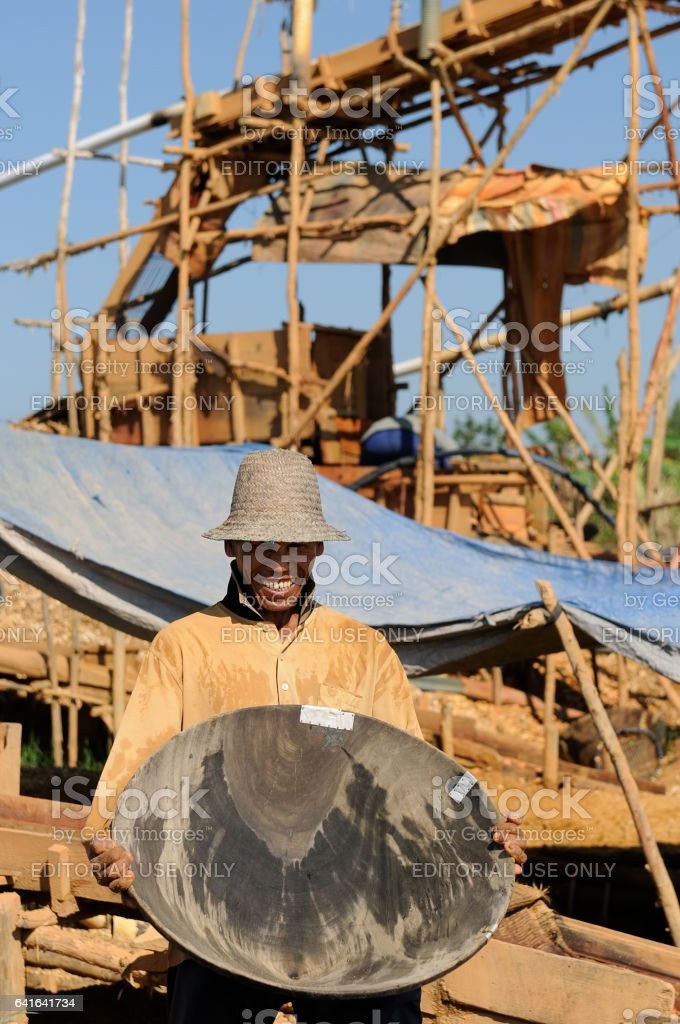 gold-digger and diamonds with traditional method on an island Borneo stock photo