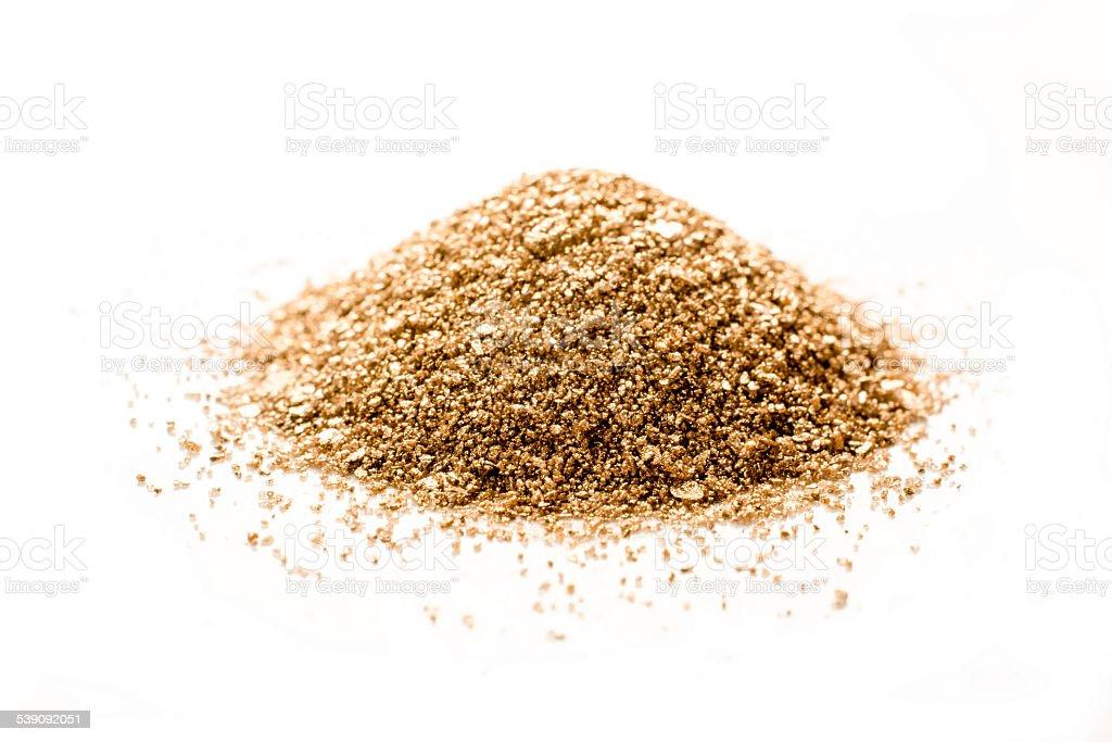 Golddust  heap side view stock photo