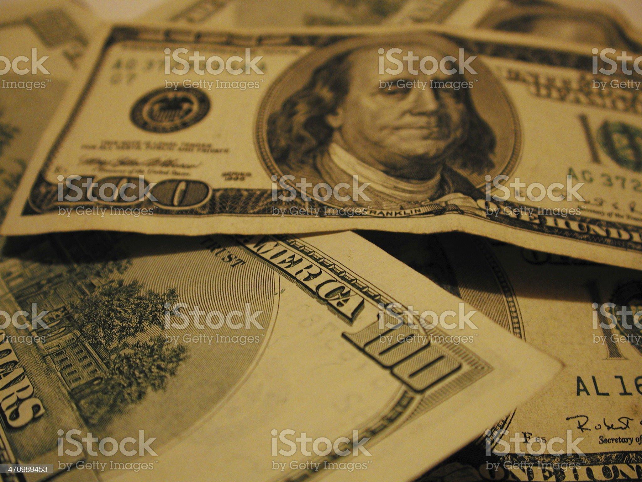 Golden $100's royalty-free stock photo