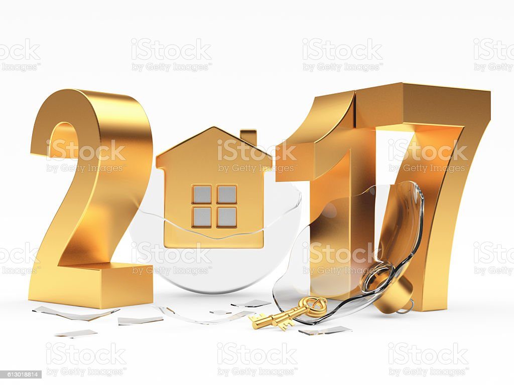 Golden 2017 and broken glass Christmas ball with house stock photo