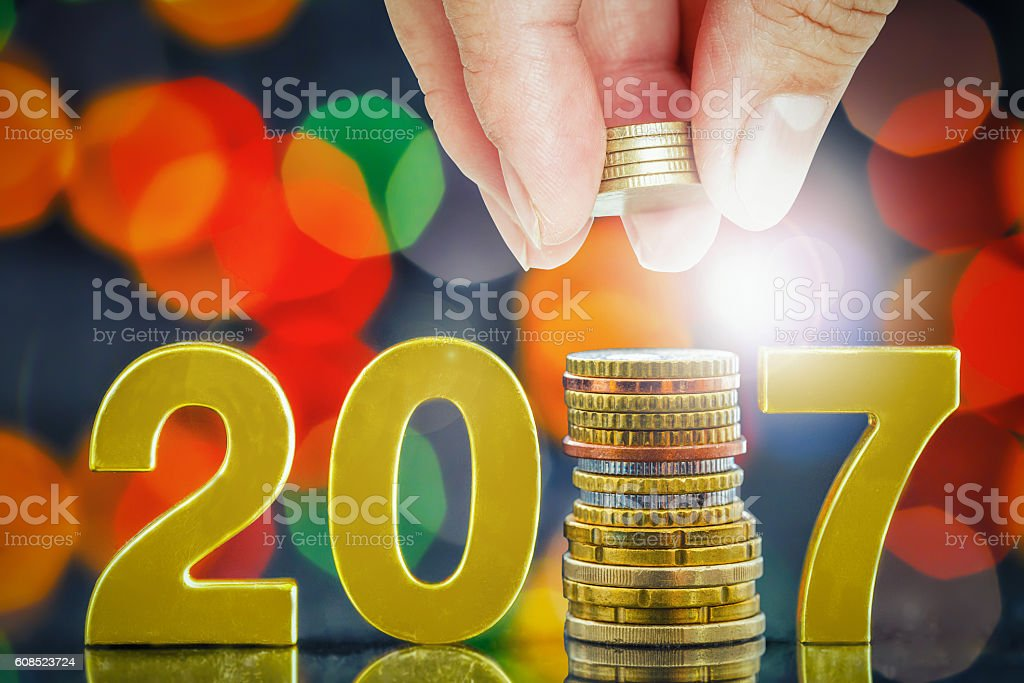 golden 2017 euro coin,money saving and investor concept stock photo