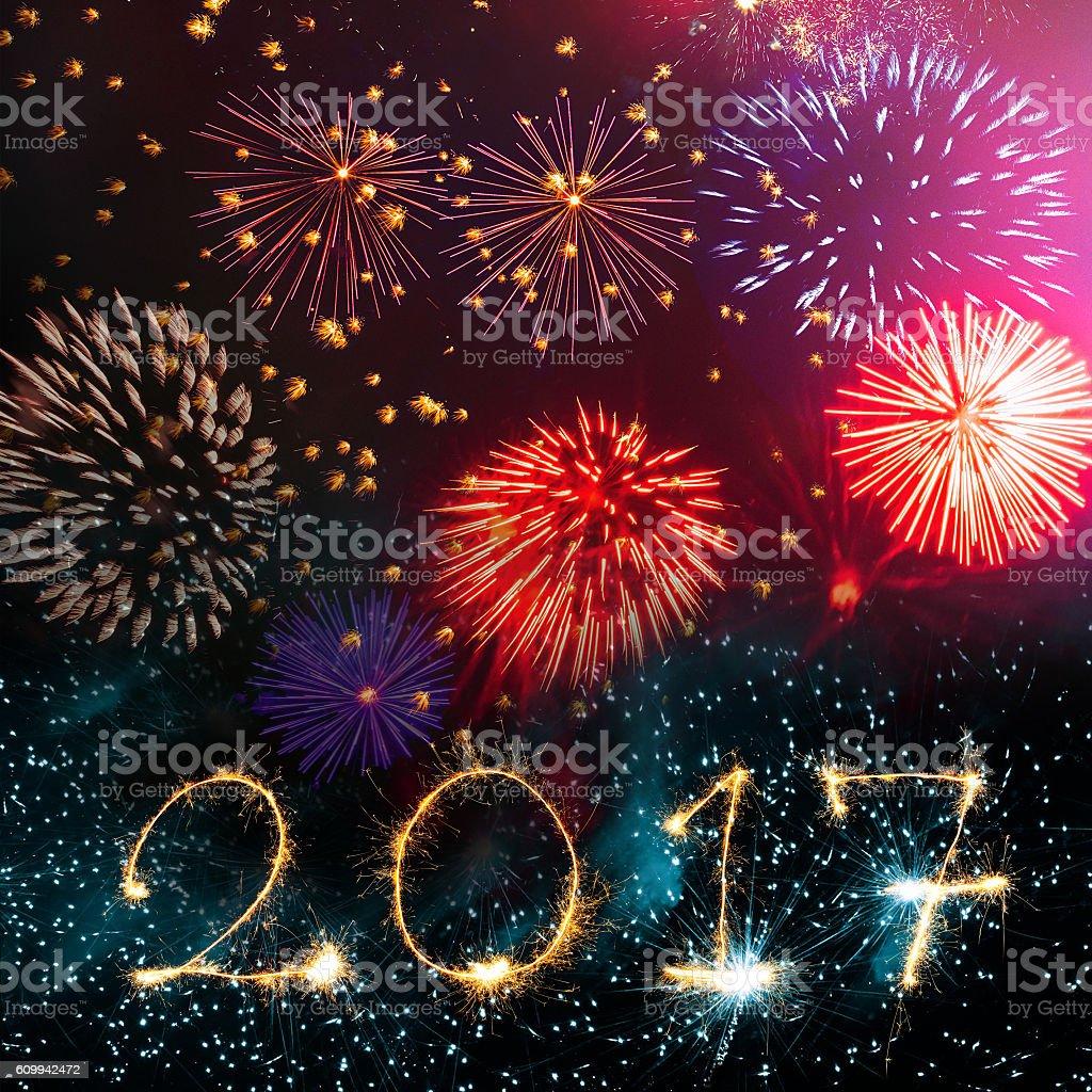 golden 2017 sparks on red gold fireworks background stock photo