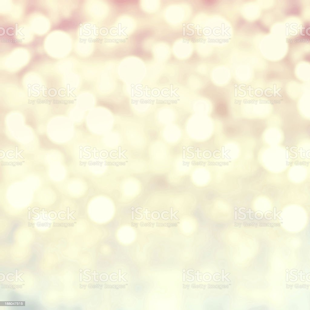 Golden Abstract Christmas background with glowing magic bokeh an royalty-free stock photo