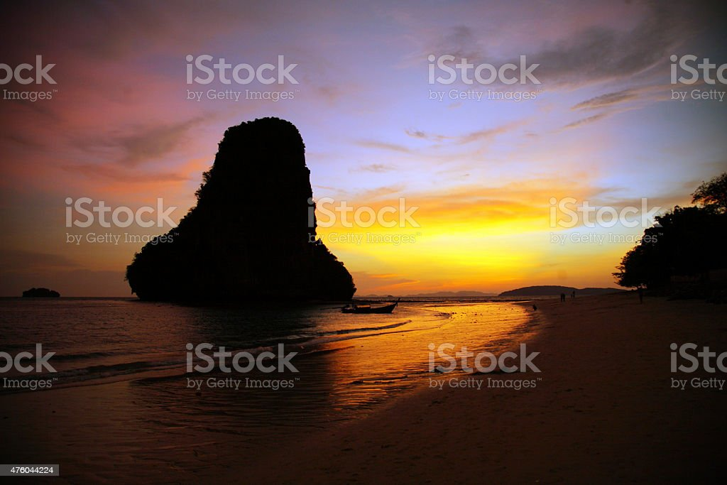 Golden afterglow of sunset along the beach in Thailand stock photo