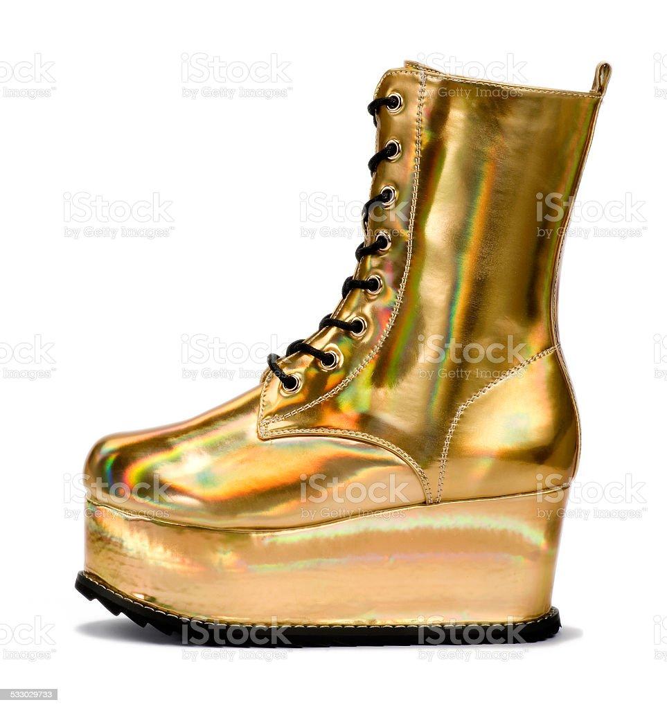 Golden alien shoe stock photo