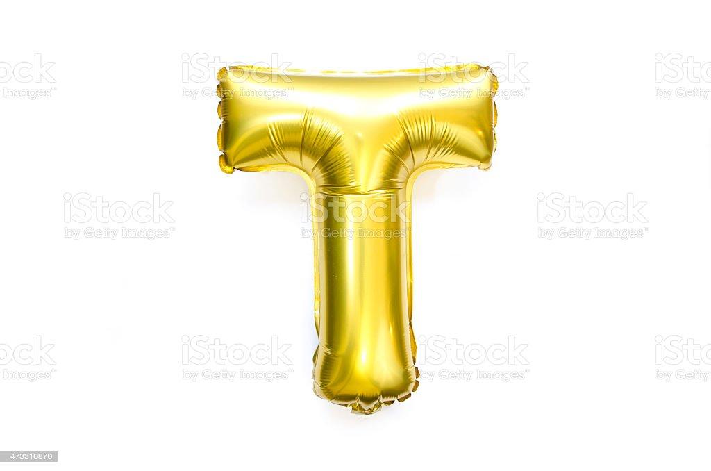Golden Alphabet Foil Balloon Letter T stock photo