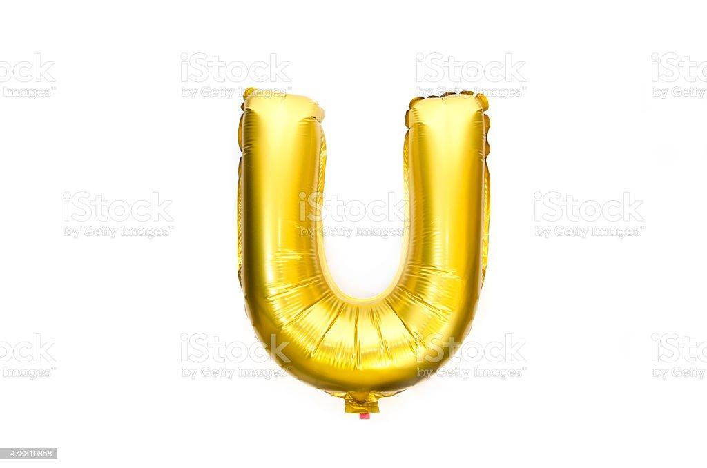 Golden Alphabet Foil Balloon Letter U stock photo