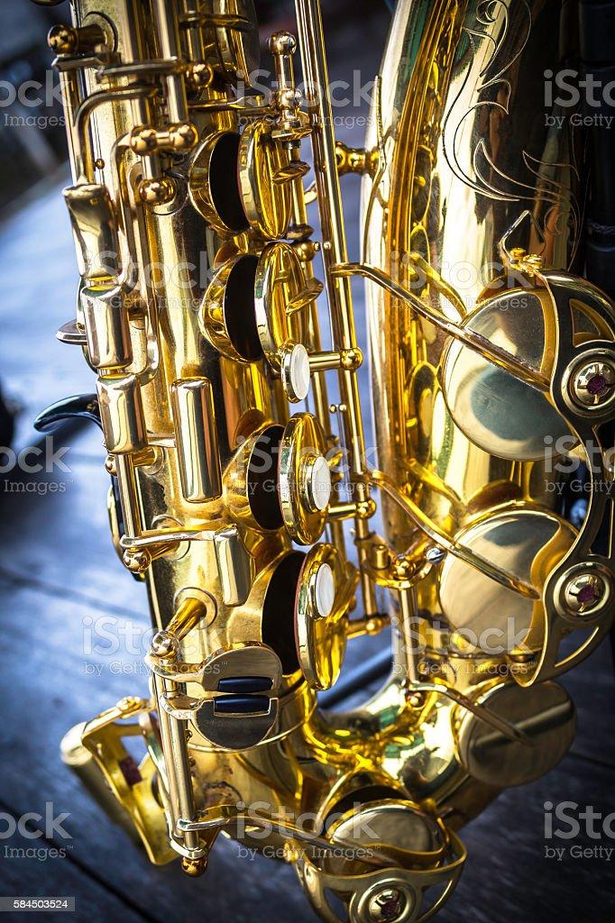 Golden alto saxophone closeup stock photo