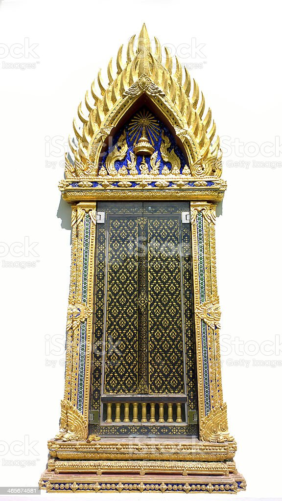 Golden Ancient  carving wooden door of Thai temple royalty-free stock photo