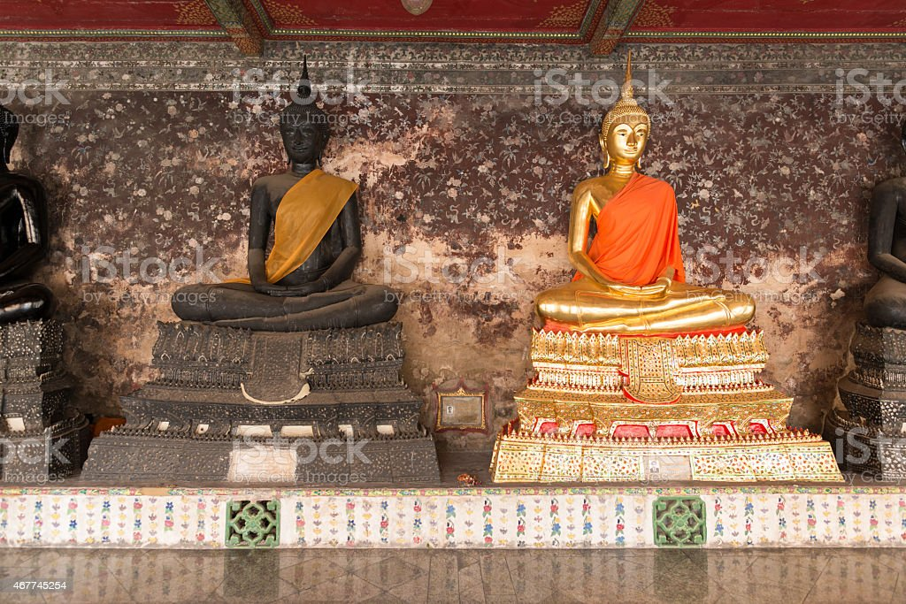 Golden and Black Buddha statues stock photo
