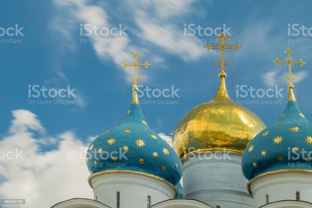 Golden and blue domes with crosses. Orthodox church. stock photo