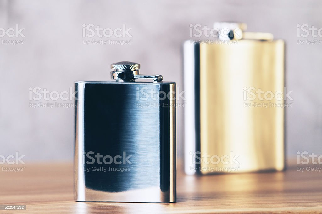 Golden and silver flask stock photo