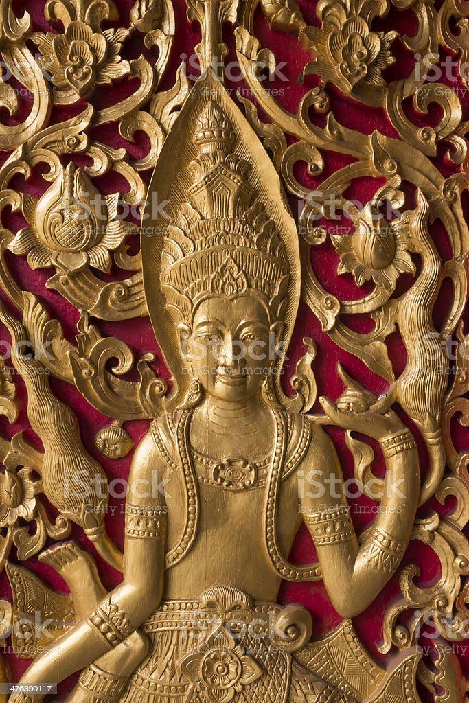 golden angel sculpture  on the door of Thai temple royalty-free stock photo