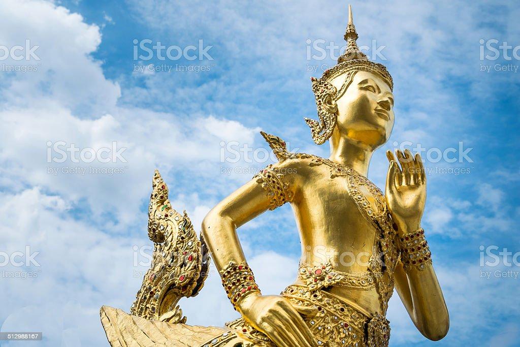 Golden angel statue, Wat phra kaeo, Bangkok, Thailand stock photo