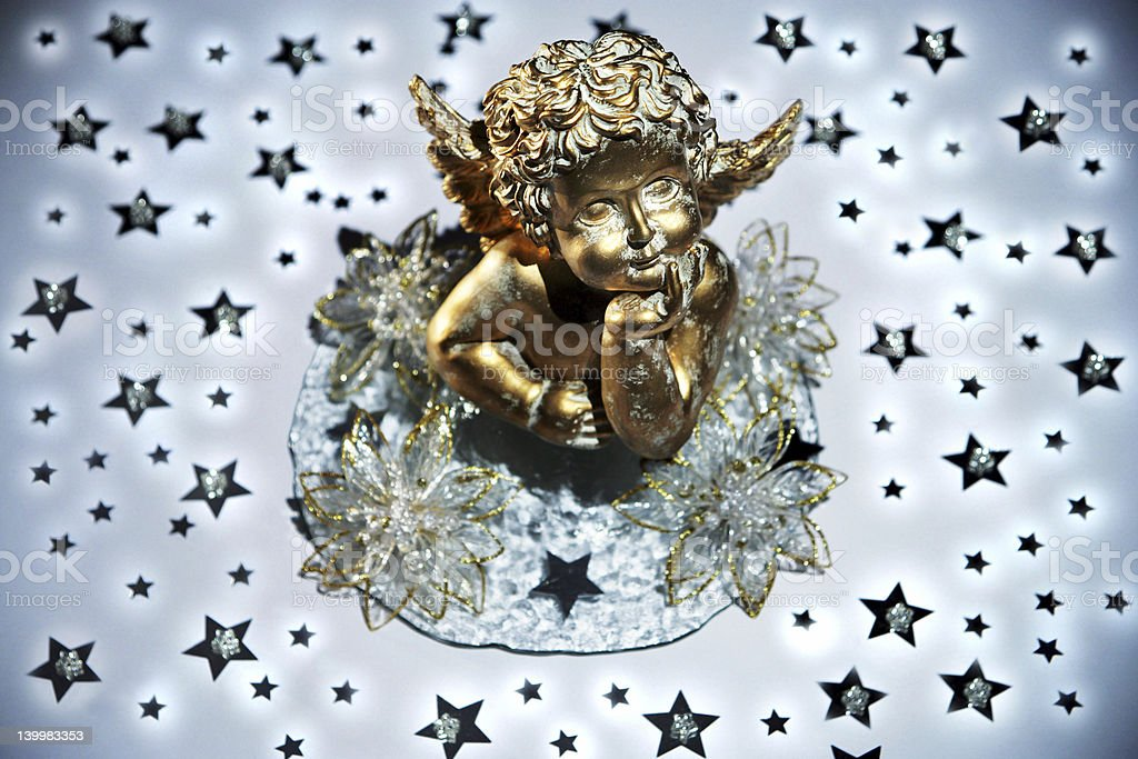 Golden angel with stars royalty-free stock photo