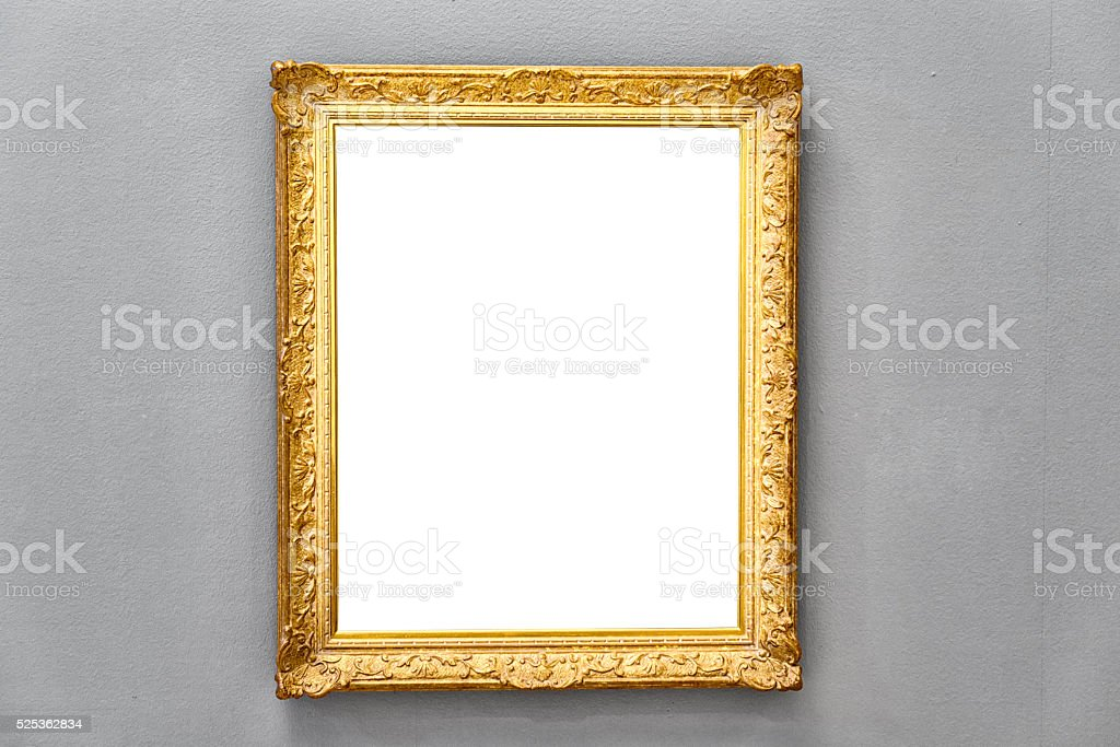 golden antique picture frame on gray wall stock photo