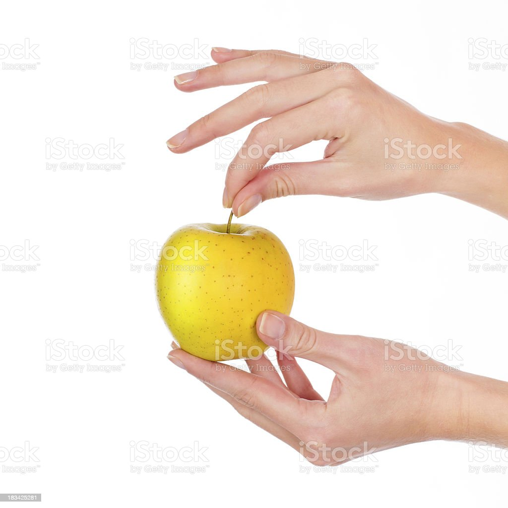 Golden apple in woman's hand royalty-free stock photo