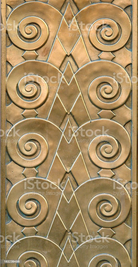 golden art deco pattern in swirls and diagonals stock photo