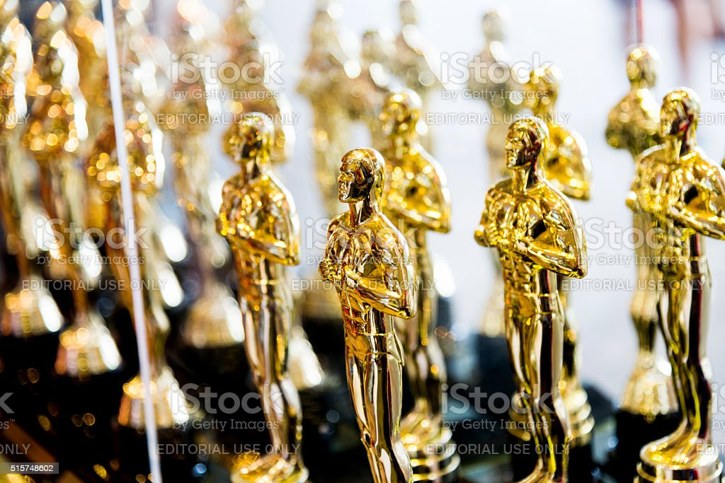 Golden award statues clone stock photo